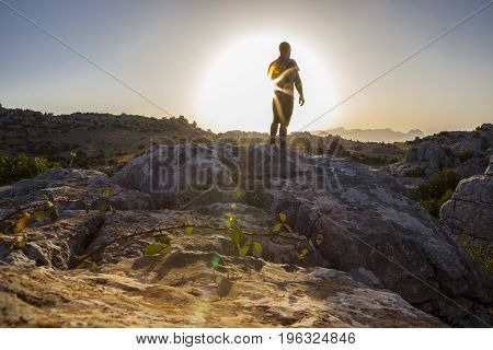 Man staring at sunrise over rocky ground. Torcal Natural Park Malaga Spain