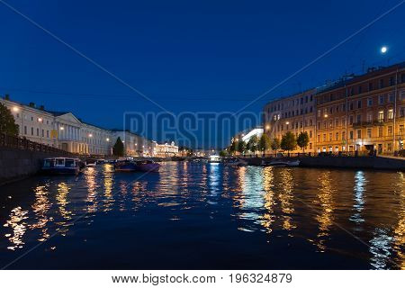 Yachts on the Fontanka River at night in St. Petersburg, Russia