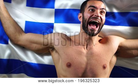 Muscular Greek Man Waving Greece Flag