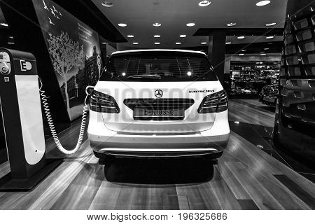 BERLIN - JANUARY 24 2015: A compact luxury car Mercedes-Benz B-Class Electric Drive. Black and white. Rear view. The first production car with an electric engine. Produced since 2014.