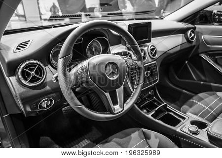 BERLIN - JANUARY 24 2015: Cabin of a compact luxury car Mercedes-Benz B-Class Electric Drive. Black and white. The first production car with an electric engine. Produced since 2014.