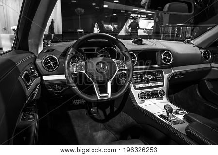 BERLIN - JANUARY 24 2015: Cabin of a sports car Mercedes-Benz SL500 (R231). Black and white. Produced since 2012.
