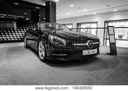BERLIN - JANUARY 24 2015: Sports car Mercedes-Benz SL500 (R231). Black and white. Produced since 2012.