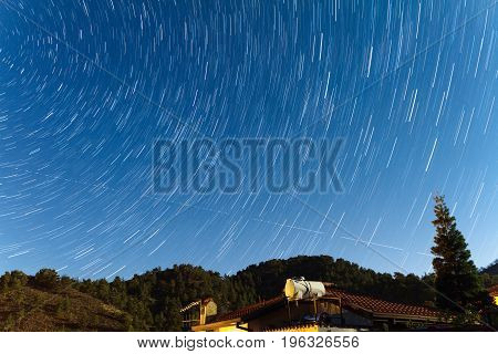 Star Trails Over A House At The Troodos Mountains.
