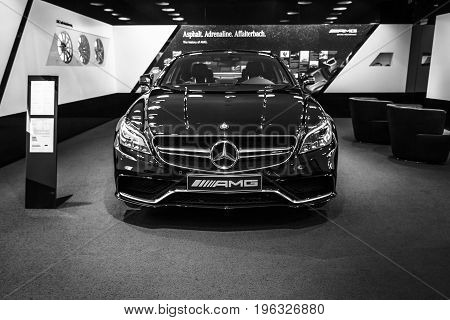 BERLIN - JANUARY 24 2015: Showroom. Mid-size luxury car Mercedes-Benz CLS 63 AMG. Black and white. Produced since 2013.