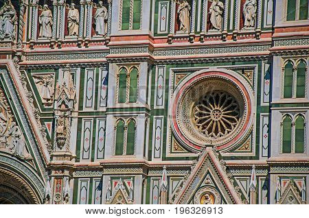 View of detail carved in marble from the facade of the Cathedral Santa Maria del Fiore in Florence, the famous and wonderful capital of the Italian Renaissance. Tuscany region. Retouched photo