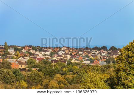 Suburban skyline. Buildings individual suburban housing in the green plants district. Dubovskoye rural settlement Belgorod Region Russia.