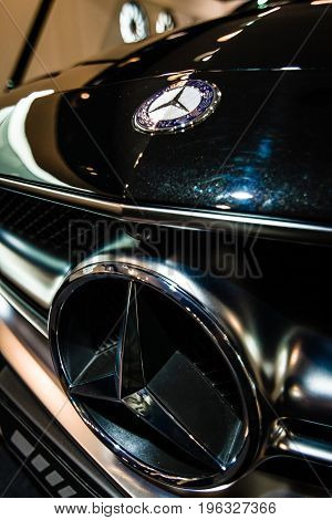 BERLIN - JANUARY 24 2015: Showroom. Hood ornament and emblem of a mid-size luxury car Mercedes-Benz CLS 63 AMG. Produced since 2013.