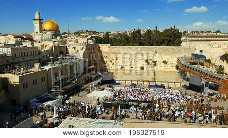 Jerusalem, Israel - May 25, 2017: People crowd with soldiers and military men at the Western wall in Jerusalem. Western wall or Wailing wall or Kotel is the most sacred place for all jewish people.