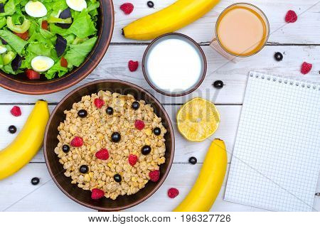 The Concept Of A Healthy Breakfast: Muesli, Banana And A Glass Of Milk On A Wooden Table, Free Space