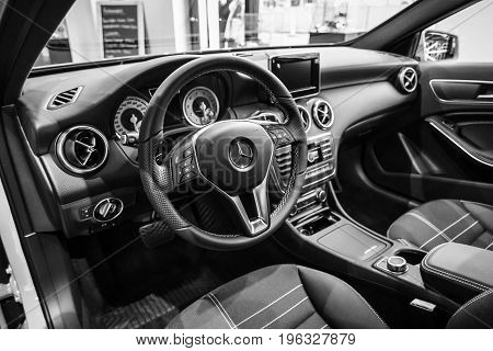 BERLIN - JANUARY 24 2015: Showroom. Interior of a compact car Mercedes-Benz A200 CGI BE. Black and white. Produced since 2013.