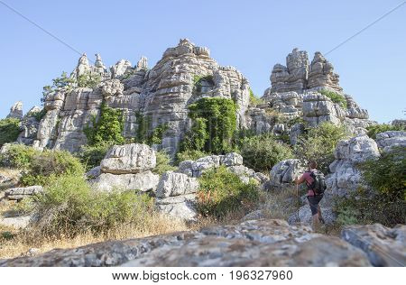 Man staring the impressive rock formations at Torcal de Antequera Malaga Spain