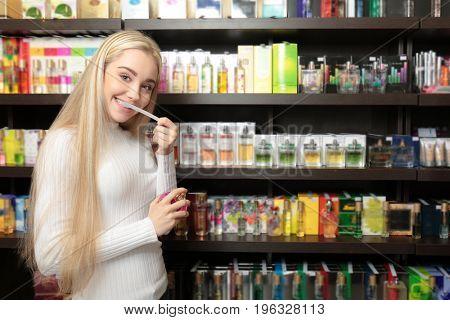 Beautiful young woman in perfumery
