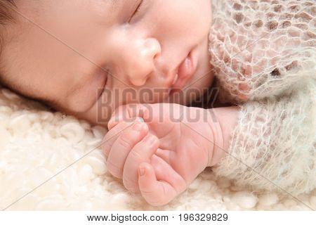 Sleeping newborn baby boy, closeup