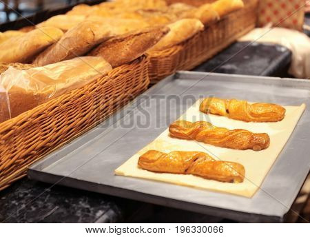 Tray with bakery products in shop, closeup