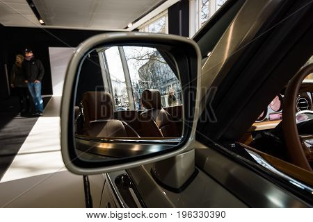BERLIN - MARCH 08 2015: Showroom. Rear-view mirrors of a luxury car Rolls-Royce Phantom Drophead Coupe. Rolls-Royce Motor Cars Limited global manufacturer of luxury cars.