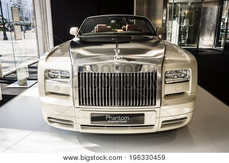 BERLIN - MARCH 08 2015: Showroom. Luxury car Rolls-Royce Phantom Drophead Coupe. Rolls-Royce Motor Cars Limited global manufacturer of luxury cars.
