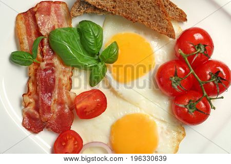 Delicious breakfast with over easy eggs on plate, closeup