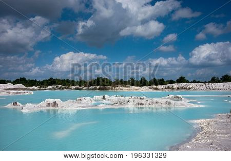 Man-made Artificial Lake Kaolin And White Land Containing Kaolinite Covered With Rain Water, Forming
