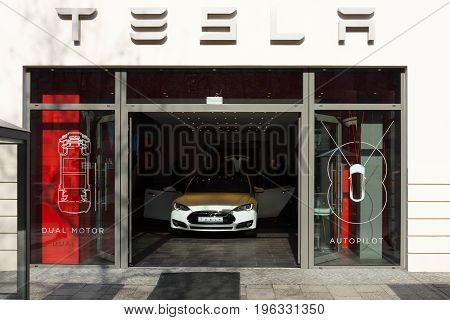 BERLIN - MARCH 08 2015: Showroom company of Tesla Motors on Kurfurstendamm. Tesla Motors Inc. is an American company that designs manufactures and sells electric cars.
