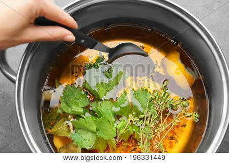 Woman preparing brine for turkey in cooking pot