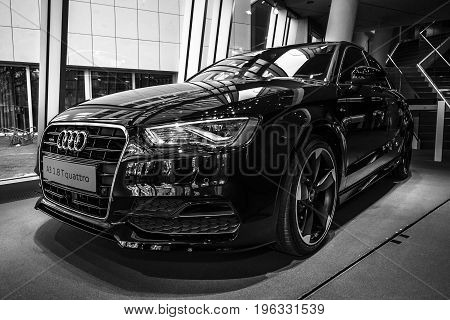 BERLIN - MARCH 08 2015: Showroom. Compact executive car Audi A3 1.8 T quattro. Black and white. Audi A3 is a winner World Car of the Year 2014