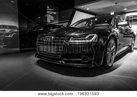 BERLIN - MARCH 08 2015: Showroom. Full-size luxury car Audi S8. Black and white. Audi AG is a German automobile manufacturer.