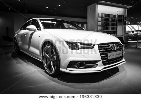 BERLIN - MARCH 08 2015: Showroom. Executive car/mid-size luxury car Audi A7 3.0 TDI quattro (2014). Black and white. Audi AG is a German automobile manufacturer.