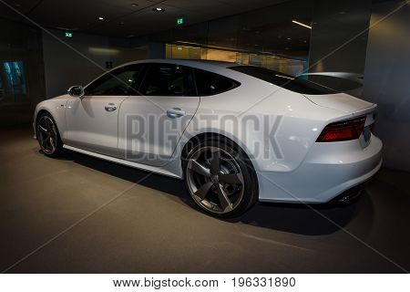 BERLIN - MARCH 08 2015: Showroom. Executive car/mid-size luxury car Audi A7 3.0 TDI quattro (2014). Audi AG is a German automobile manufacturer.