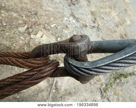 Metal fastening of two steel cables ,