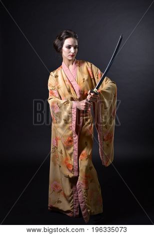 Woman In Kimono With Sword.