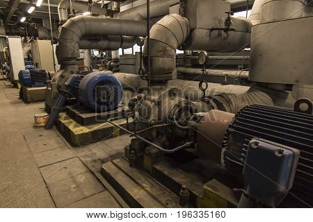 some old dusty pumps for hot and cold water with large electric motors