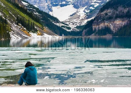 A Woman Enjoying the View of Frozen Iced Lake Louise