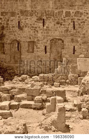 ancient ruins of old stone fortress of color sepia