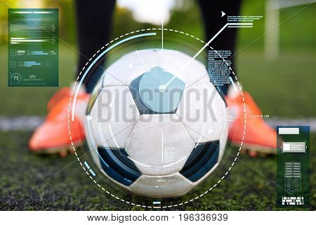 sport, football and technology concept - soccer player with ball on football field