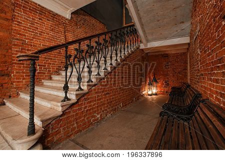 Modern industrial creative workspace. staircase with textured brick walls to the attic loft.