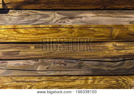 Old shabby wood aged plank close-up. Wooden texture with scratches and cracks Creative natural backdrop for vintage design