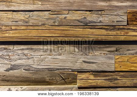 Close-up of Old shabby wood aged plank close-up. Wooden texture with scratches and cracks. With place for your text, for background, vintage design
