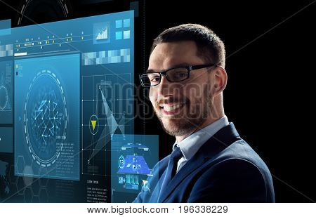 business, people and technology concept - smiling businessman in glasses over black background with virtual screens