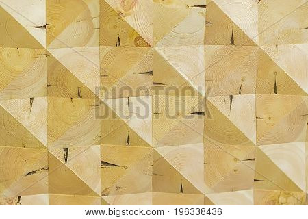 Abstract decorative ecological unpainted light wood backdrop, geometric mosaic pattern, natural surface. Art wooden background. Texture with scratches, cracks