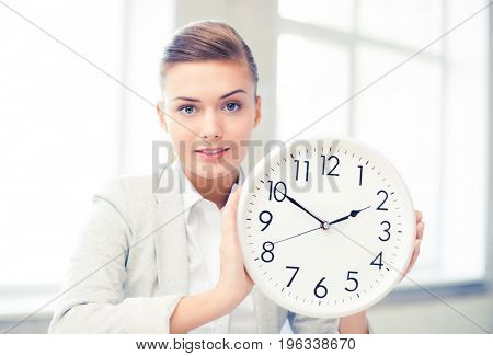 picture of attractive businesswoman showing white clock
