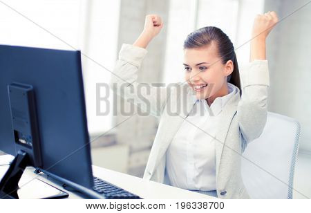 picture of happy businesswoman with computer in office