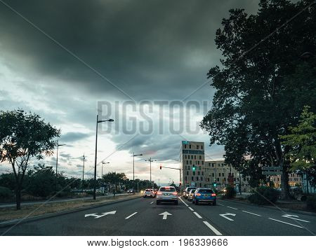 STRASBOURG FRANCE - 30 jun 2017: Entrance to Strasbourg from Germany with the RHENA hospital clinic and scary clouds above the city