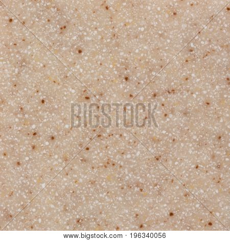 Close up of Texture new wall of small light beige artificial stone. High resolution photo.