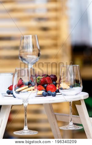 Wine Glasses And Fresh Berries. Why This Design Is Not Know.