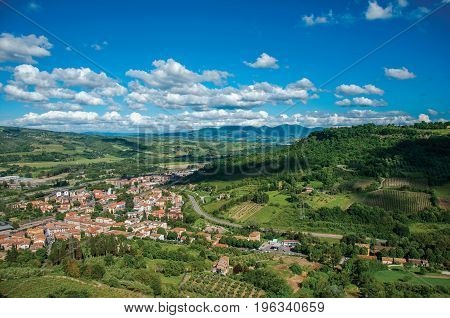 Overview green hills, vineyards and town rooftops near a road. From the city center of Orvieto, an ancient, pleasant and well preserved medieval town. Located in Umbria, central Italy poster