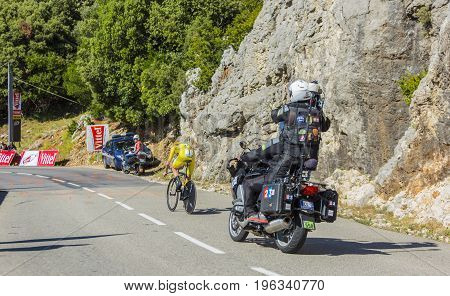 Col du Serre de TourreFrance - July 152016: The British cyclist Christopher Froome of Team Sky in Yellow Jersey is riding during an individual time trial stage in Ardeche Gorges on Col du Serre de Tourre during Tour de France 2016.