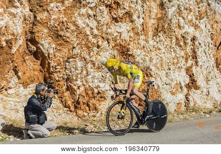 Col du Serre de TourreFrance - July 152016: Photographer taking a photo of the British cyclist Christopher Froome of Team Sky in Yellow Jersey is riding during an individual time trial stage in Ardeche Gorges on Col du Serre de Tourre during Tour de Franc