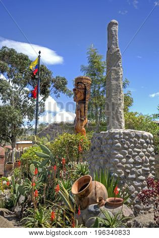 Totems, plants, stone statues and other relics found in the Middle of the World park, north of Quito, Ecuador