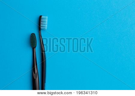 Black toothbrushes , space for text